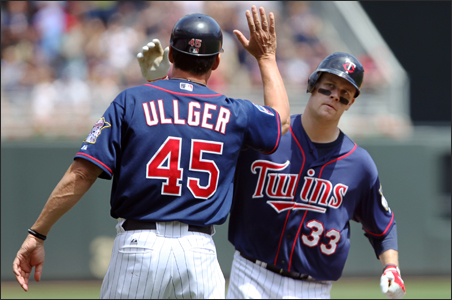 Minnesota Twin Justin Morneau celebrated last year with Scott Ullger, then third base coach.