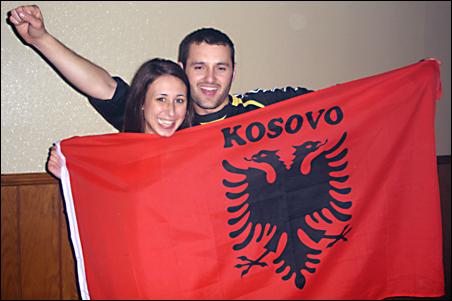 College of St. Benedict student Jehona Syla celebrated with fellow student and Kosovar Sylejman Ujkani