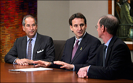 Tom Glocer, chief executive of Thomson Reuters, left, and Peter Warwick, right, chief executive of North American Legal, looked on as Gov. Pawlenty signed a Minnesota broadband bill into law at the Thomson Reuters campus in Eagan, April 18, 2008.