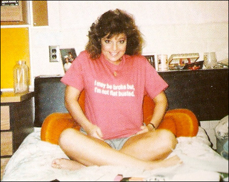 """The most controversial photo in the book shows a college-age Sarah Palin wearing a T-shirt that reads: """"I may be broke but I'm not flat busted."""""""