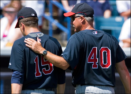 Pitching coach Rick Anderson confers with pitcher Glen Perkins during a March 15 spring exhibtion game in Tampa.