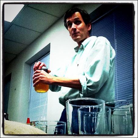 John Middleton mixes a cocktail