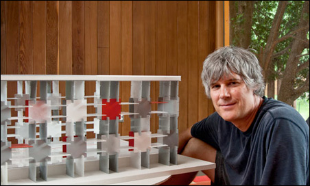 Kerrik Wessel with a model of the wall of his Parasol Modular carport.