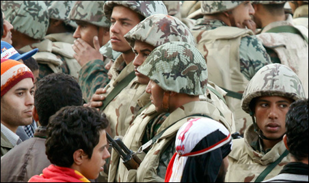 Opposition supporters faced Egyptian soldiers at Tahrir Square in Cairo on Sunday.