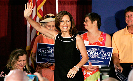 Michele Bachmann waves during a rally in Florence, South Carolina, on Thursday.