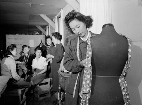 Dressmaking class, Manzanar Relocation Center, California, 1943, by Ansel Adams