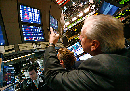 Traders work on the floor of the New York Stock Exchange Monday.