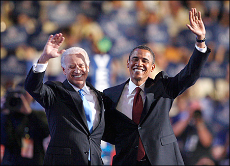 Sens. Joseph Biden and Barack Obama appear onstage at the Democratic National Convention Wednesday night.