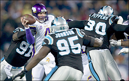 Brett Favre is sacked by a host of Carolina Panthers defenders during the Vikings loss to the Panthers Sunday.