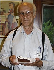 Al Sicherman holding a piece of Chocolate Legal.
