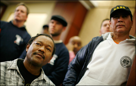 Unemployed workers listen to remarks during a Dec. 1 news conference on the expiration of unemployment benefits.