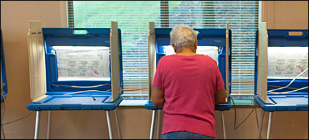A voter fills out her ballot at a Glendale polling place on Tuesday.