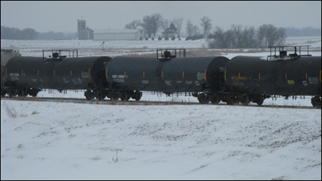 Tanker cars traveling in southwestern Minnesota's farming countryside while servicing an ethanol plant near Albert Lea, Minn. Ethanol plants put stress on the surrounding environment by increasing rail and truck traffic in the area.