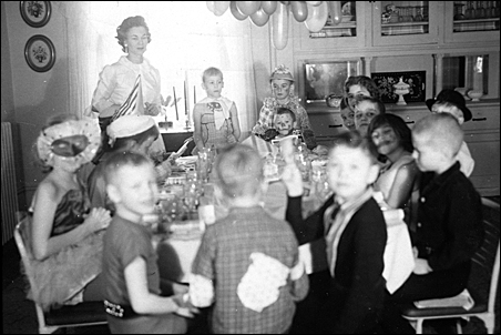 March 1958: The author's mother, LaVonne Watson, and her sister Elizabeth's eighth birthday party with neighborhood children.