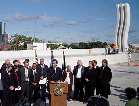 Gov. Tim Pawlenty, flanked by the Minnesota congressional delegation, Mayor R.T. Rybak and other dignitaries, speaks on the bridge at a press conference Monday.