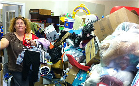 Julia Sonnen, founder of Families Helping Each Other, sorting through a truckload of donations.