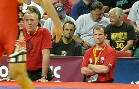 Coaches -- and former Olympians -- Dan Chandler, left, and Brandon Paulson intently watch wrestling phenom Jake Deitchler at the Olympic trials in Las Vegas.