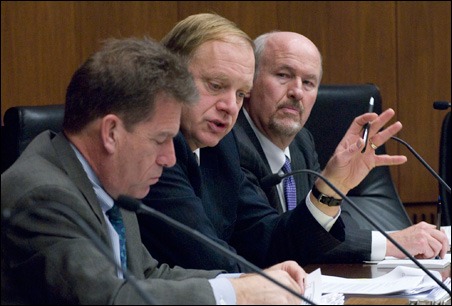 Members of the Canvassing Board discuss challenged ballots today. From the left are Secretary of State Mark Ritchie, Supreme Court Justice G. Barry Anderson and Ramsey County District Judge Ed Cleary.