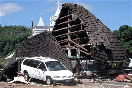 A destroyed structure is seen among debris near a church following a series of tsunami waves that struck the village of Leone, American Samoa, Tuesday, Sept. 29, 2009.