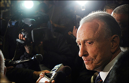 Sen. Arlen Specter fields media questions during a news conference at his campaign reception hall on Tuesday.