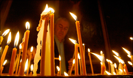 A man lights candles during a religious service last Friday at an Armenian church in Tbilisi marking the anniversary of mass killings of Armenians in the Ottoman Empire in 1915.