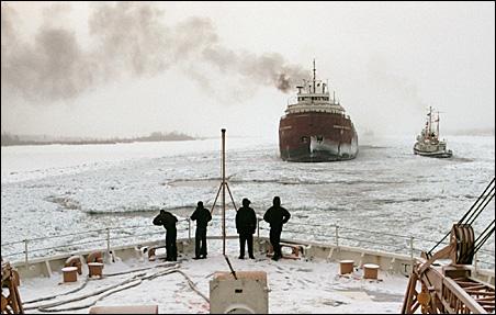 Cargo ships move through ice on Lake Superior.