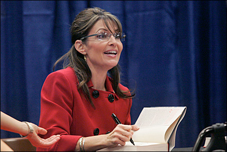 Sarah Palin signs her new book 'Going Rogue' at a Barnes and Noble book store in Grand Rapids, Michigan, on Wednesday.