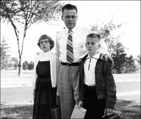 About 1955: Author, her father Richard Watson and brother Steven prepare for the first day of school.