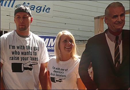 GOP trackers Jordan Hanson and Abby Michaud pose with a cardboard cutout of DFL gubernatorial candidate Mark Dayton at the State Fair.