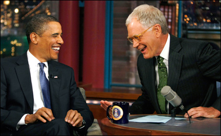 """President Barack Obama laughs during the taping on his guest appearance on the """"Late Show with David Letterman"""" show in New York, September 21, 2009."""