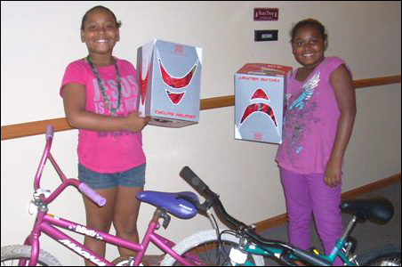 Sisters Rickea, left, and Ricala with their bikes and helmets.