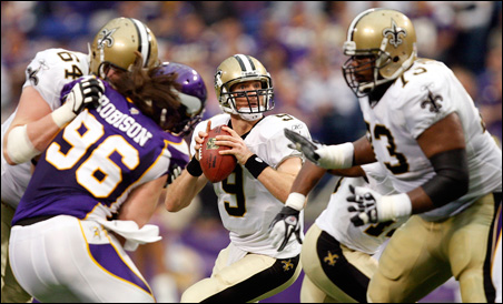 Drew Brees attempting to pass during the first half of Sunday's game.