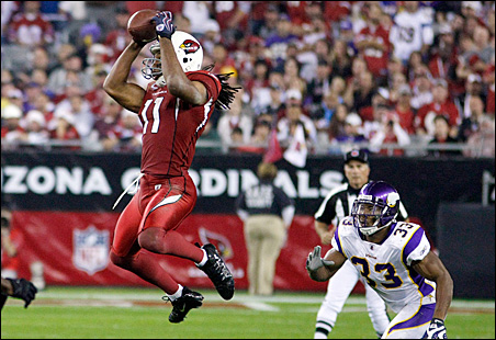 Arizona Cardinals wide receiver Larry Fitzgerald makes a catch in front of the Vikings' Cedric Griffin in the third quarter.