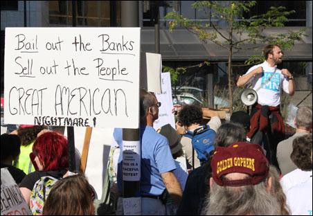 A speaker addressing an OccupyMN rally.