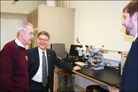 Medical Devices Center Director Art Erdman, Senator Al Franken and lab supervisor Lucas Harder.
