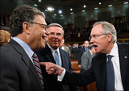 Sen. Al Franken jokes with U.S. Senate Majority Leader Harry Reid, right, on the floor of the House Chamber before President Barack Obama's speech about healthcare reform on September 9, 2009.