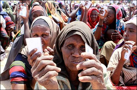 Displaced Somali women wait to receive U.N. non-food items in Mogadishu on Wednesday.