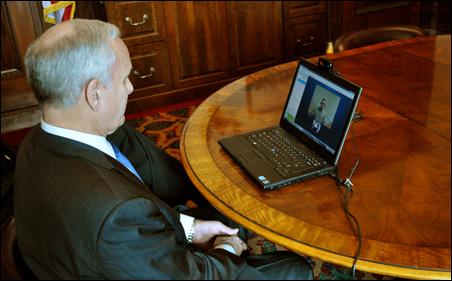 Gov. Mark Dayton interviewing Capt. Ross Leuning in Iraq via Skype.