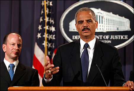 Attorney General Eric Holder, right, announces charges of terrorism violations against 14 people for providing resources to the foreign organization al-Shabaab. At left is Assistant Attorney General for National Security David Kris.