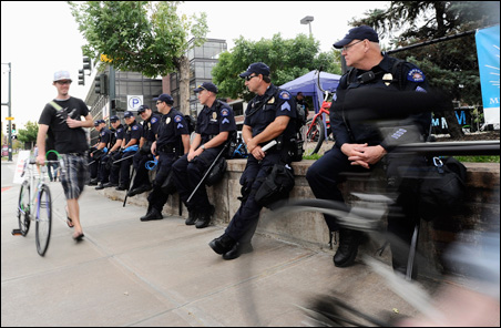 On Saturday, two days before the convention's start, police officers already were lined up to watch pedestrians outside the Pepsi Center in Denver.