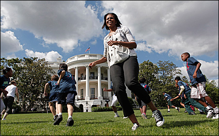 Michelle Obama runs with school children on the South Lawn on May 25.