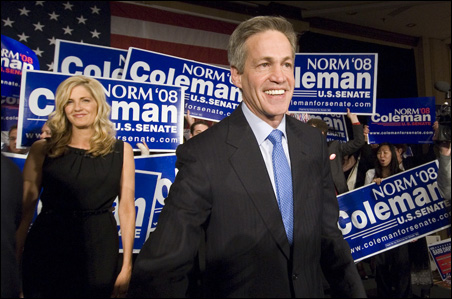 Sen. Norm Coleman and his wife, Laurie, met with supporters Tuesday night while awaiting vote returns, which showed the incumbent ahead by a razor-thin margin.