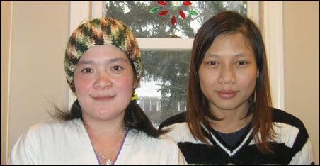 Kaw Tha Blay Paw, who came to St. Paul from a refugee camp in Thailand, told her story through MORE translator Day Wah, right.