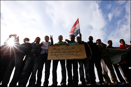 Protesters wave an Egyptian flag during a demonstration in Tahrir Square in Cairo.