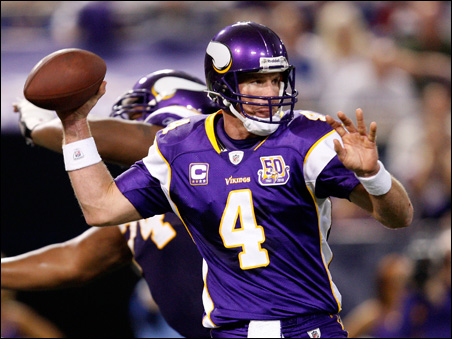 Brett Favre throws a pass during the second quarter of Sunday's game.