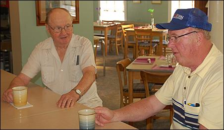 Tony Felling, left, of Sauk Centre, and Alvin Thull of rural Sauk Centre visit at the Palmer House in Sauk Centre.