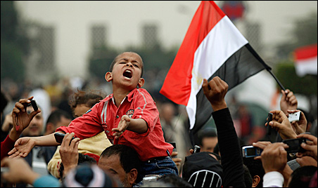 A young protester chants anti-government slogans during demonstrations inside Tahrir Square in Cairo on Monday.