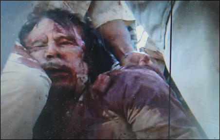 A still image taken from video footage purported to be the corpse of former Libyan leader Muammar Gaddafi.