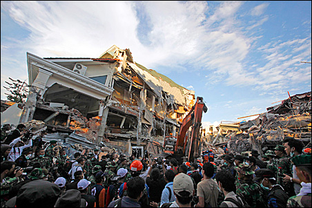 Rescue workers look for survivors inside the Ambacan Hotel which collapsed in the earthquake stricken area of Padang, West Sumatra province, Friday, Oct. 2, 2009.