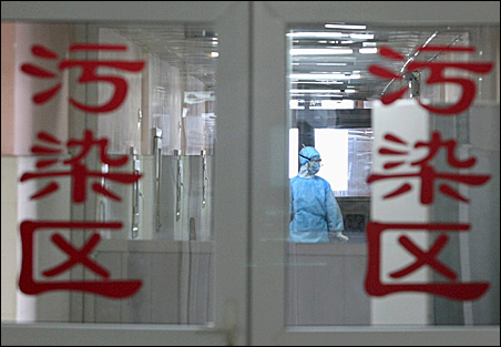 A health worker wearing a protection suit is seen inside the contaminated zone at a hospital in Chengdu, Sichuan province.